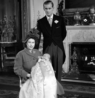 Prince Charles with his mother and father after his christening
