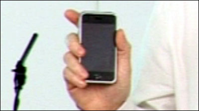 Google Chief Executive Eric Schmidt shows his iPhone after being asked about company partnerships.