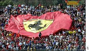 Audience at F1 race hold a massive Ferrari flag