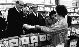 Lord Fiske, Chairman of the Decimal Board, pictured in 1971 in The Strand in London in a Woolworth's store