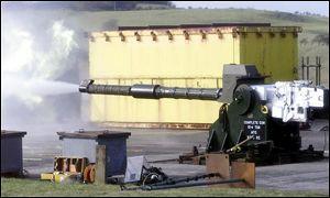 Gun firing shell