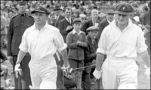 1930: Sir Donald Bradman (l) heads out to bat against England at Leeds