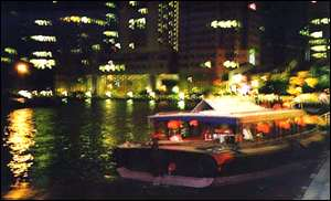 Night boat in Singapore harbour