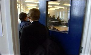 secondary school pupils entering classroom