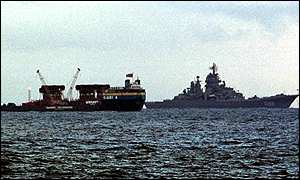 Giant 4 barge in Barents Sea with Russian Navy cruiser
