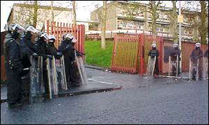 RUC officers protect the entrance to Holy Cross School