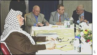 Palestinian Authority cabinet: left to right: Arafat, Ahmed Qurei (parliament speaker), Yasser Abed Rabbo (information culture), Saeb Erekat (local govt)