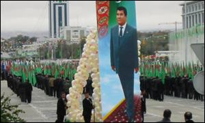 A poster of the president is carried through the streets of Ashgabat during a parade (pictures: Rory Mulholland)