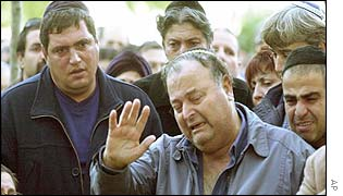 An Israeli man at his son's funeral