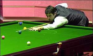 Ronnie O'Sullivan at the table