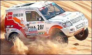 Hiroshi Masuoka in his Mitsubishi on the way to winning the 10th stage of the Paris-Dakar Rally