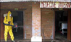 Spraying a hospital in Gabon