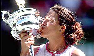 Jennifer Capriati kisses the Australian Open trophy