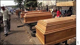 Coffins stand ready for sale outside the Ikeja mortuary in Lagos