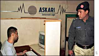 Police in a Karachi cyber cafe, AP