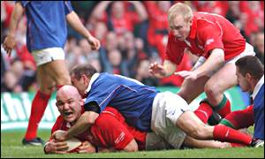 Craig Quinnell bursts over the line for Wales' opening try