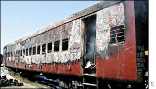 The gutted wreckage of one of the train cars