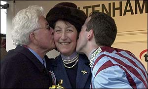Best Mate's owner Jim Lewis and the jockey Jim Culloty shower trainer Henrietta Knight with kisses