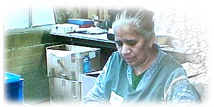 Kamela, an employee at a whistle-making factory in Birmingham