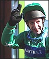 Jim Culloty celebrates his Grand National victory