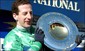 Jim Culloty celebrates after his Grand National victory