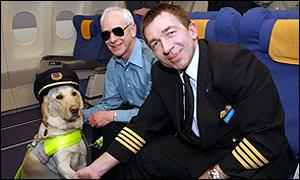 Guide dog Terry, his owner Ken Weinling and Captain David Robertson