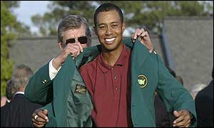 Tiger Woods (right) is presented with his green jacket by Augusta boss Hootie Johnson