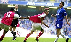 Thierry Henry celebrates with Freddie Ljungberg after the Swede scores for the second final in a row