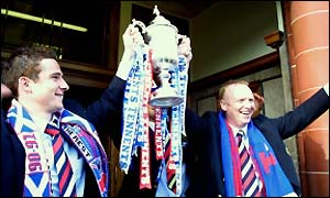 Rangers' skipper Barry Ferguson (left) and boss Alex McLeish parade the Scottish Cup outside Ibrox
