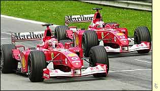 Rubens Barrichello (right) hands Michael Schumacher victory in the Austrian Grand Prix