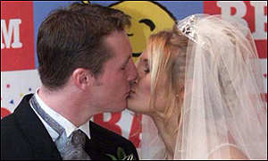 First kiss ... on their wedding day