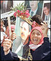 Bashar supporters wave placards