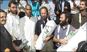 The hostages with Colonel Gaddafi's son (third from left) and Libyan negotiator (left)
