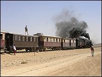 Steam train travelling through the desert