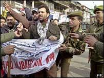 Policemen detain Jammu Kashmir Liberation Front or JKLF chairman Javed Mir