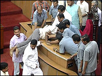 Security staff in Orissa assembly trying to control angry legislators