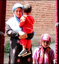 Women with children, listening to Ms Andrabi