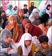 Women and children listen to Asiya Andrabi