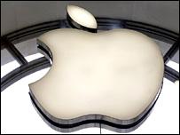 Apple logo reflected in a window