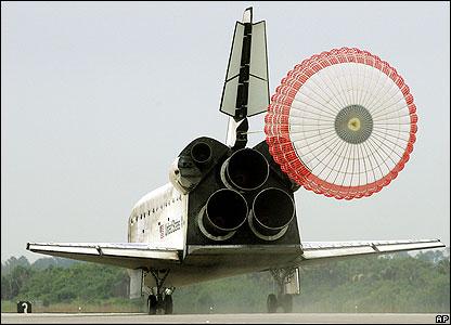 during a space shuttle landing a parachute deploys - photo #12