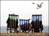 Sunbathers on deckchairs