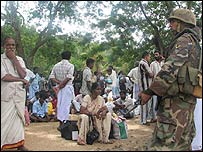 Tamil residents of Jaffna wait to board buses to escape fighting