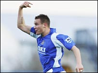 Matthew Taylor celebrates his spectacular strike for Portsmouth