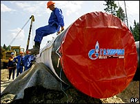 A worker jumps down from a gaspipe at the construction site of the Baltic gas pipeline near Boksitogorsk