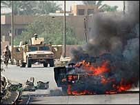 Vehicle burning after roadside bombing