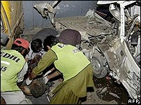 Rescuers at one of the Quetta blast sites