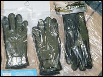 Angler's gloves in Khan's boxes