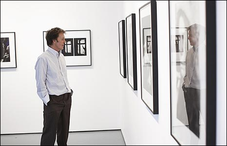 Sir Paul inspects some photographs taken by his late wife - click to see more