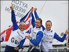 Sarah Ayton, Sarah Webb and Pippa Wilson of Great Britain celebrate victory in the Yngling class medal race