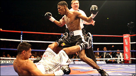 Breidis Prescott (right) celebrates as Amir Khan hits the deck at the MEN Arena